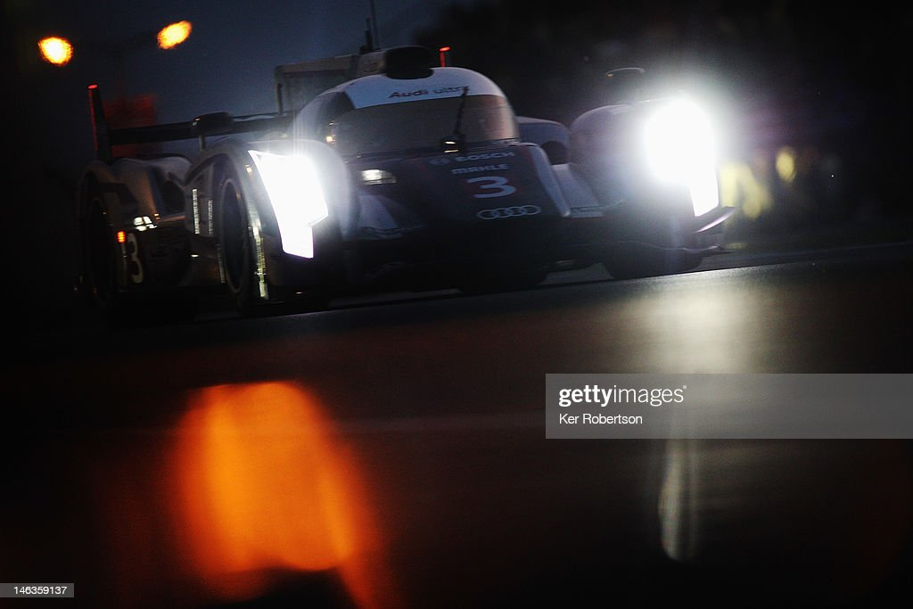 The Audi Sport R18 Ultra of <a gi-track='captionPersonalityLinkClicked' href=/galleries/search?phrase=Marc+Gene&family=editorial&specificpeople=217824 ng-click='$event.stopPropagation()'>Marc Gene</a>, Romain Dumas and Loic Duval drives during qualifying for the Le Mans 24 Hour race at the Circuit de la Sarthe on June 14, 2012 in Le Mans, France.