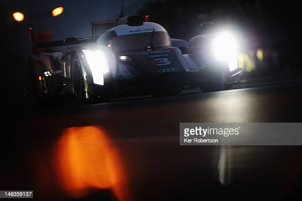 The Audi Sport R18 Ultra of Marc Gene Romain Dumas and Loic Duval drives during qualifying for the Le Mans 24 Hour race at the Circuit de la Sarthe...