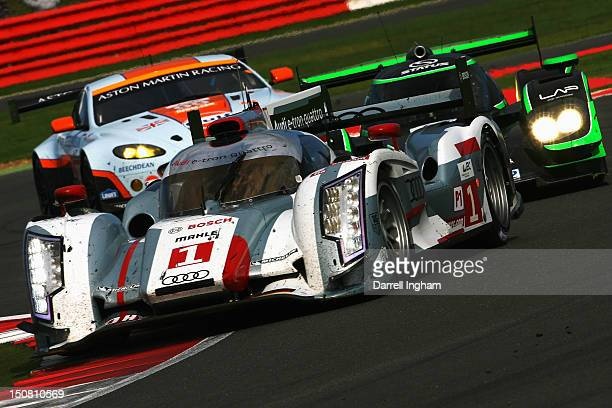 The Audi Sport Team Joest Audi R18 etron Quattro driven by Andre Lotterer Benoit Treluyer and Marcel Fassler leads during the FIA World Endurance...