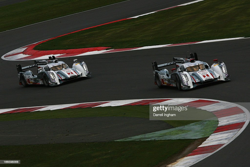 The #1 Audi Sport Team Joest Audi R18 e-tron quattro Hybrid driven by <a gi-track='captionPersonalityLinkClicked' href=/galleries/search?phrase=Andre+Lotterer&family=editorial&specificpeople=2380096 ng-click='$event.stopPropagation()'>Andre Lotterer</a> of Germany, <a gi-track='captionPersonalityLinkClicked' href=/galleries/search?phrase=Benoit+Treluyer&family=editorial&specificpeople=4333474 ng-click='$event.stopPropagation()'>Benoit Treluyer</a> of France and <a gi-track='captionPersonalityLinkClicked' href=/galleries/search?phrase=Marcel+Fassler&family=editorial&specificpeople=558832 ng-click='$event.stopPropagation()'>Marcel Fassler</a> of Switzerland leads the #2 Audi during the FIA World Endurance Championship 6 Hours of Silverstone sportscar race at the Silverstone Circuit on April 14, 2013 in Towcester, United Kingdom.