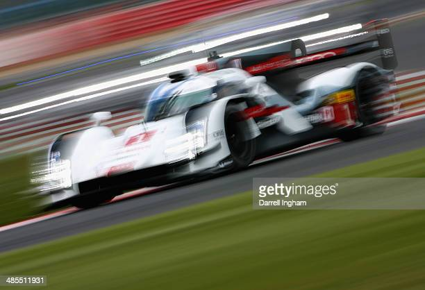 The Audi Sport Team Joest Audi R18 etron quattro LMP1 driven by Tom Kristensen of Denmark Loic Duval of France and Lucas di Grassi of Brazil during...