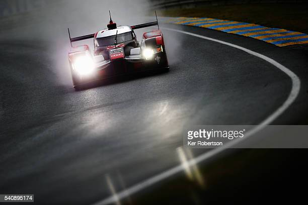 The Audi Team Joest R18 of Marcel Fassler Andre Lotterer and Benoit Treluyer drives during qualifying for the Le Mans 24 Hour race at the Circuit de...