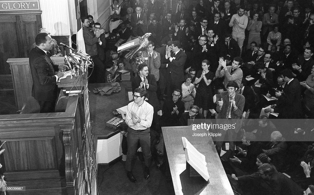 The audience applauds American Civil Rights leader Dr Martin Luther King Jr speaks from a lecturn at the New York Avenue Presbyterian Church...