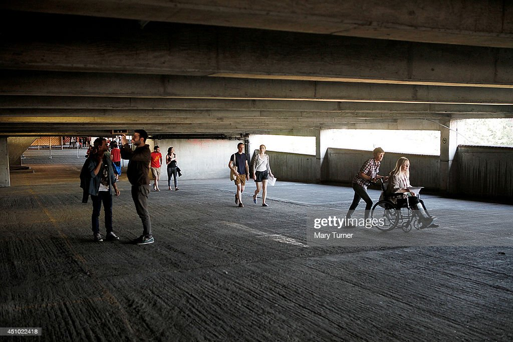 The audience arrive in Peckham Rye car park to hear The MultiStory Orchestra perform Jean Sibelius' 5th Symphony on June 21 2014 in London England...