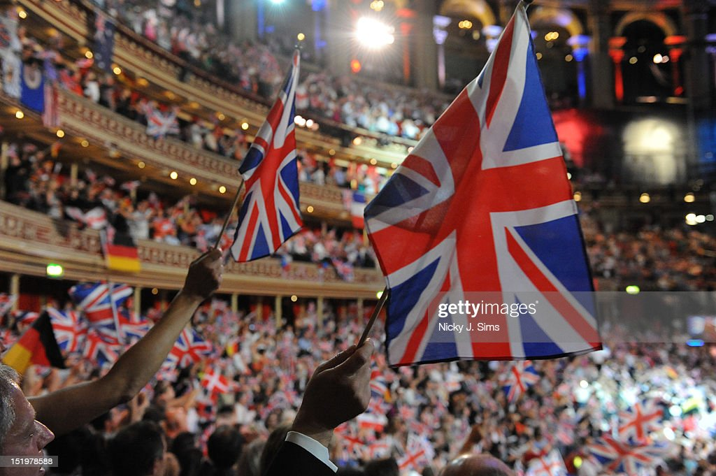 The audience at the Royal Albert Hall wave their flags and sing along jubilantly during the climax of the Last Night Of The Proms at Royal Albert Hall on September 8, 2012 in London, United Kingdom.