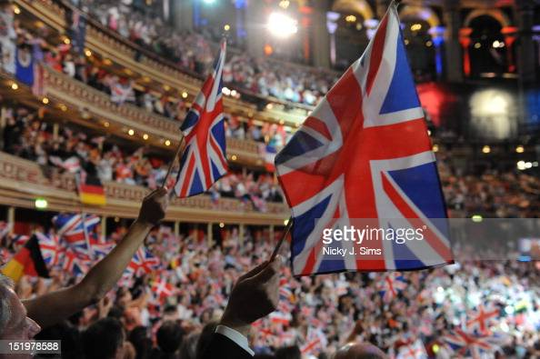 The audience at the Royal Albert Hall wave their flags and sing along jubilantly during the climax of the Last Night Of The Proms at Royal Albert...
