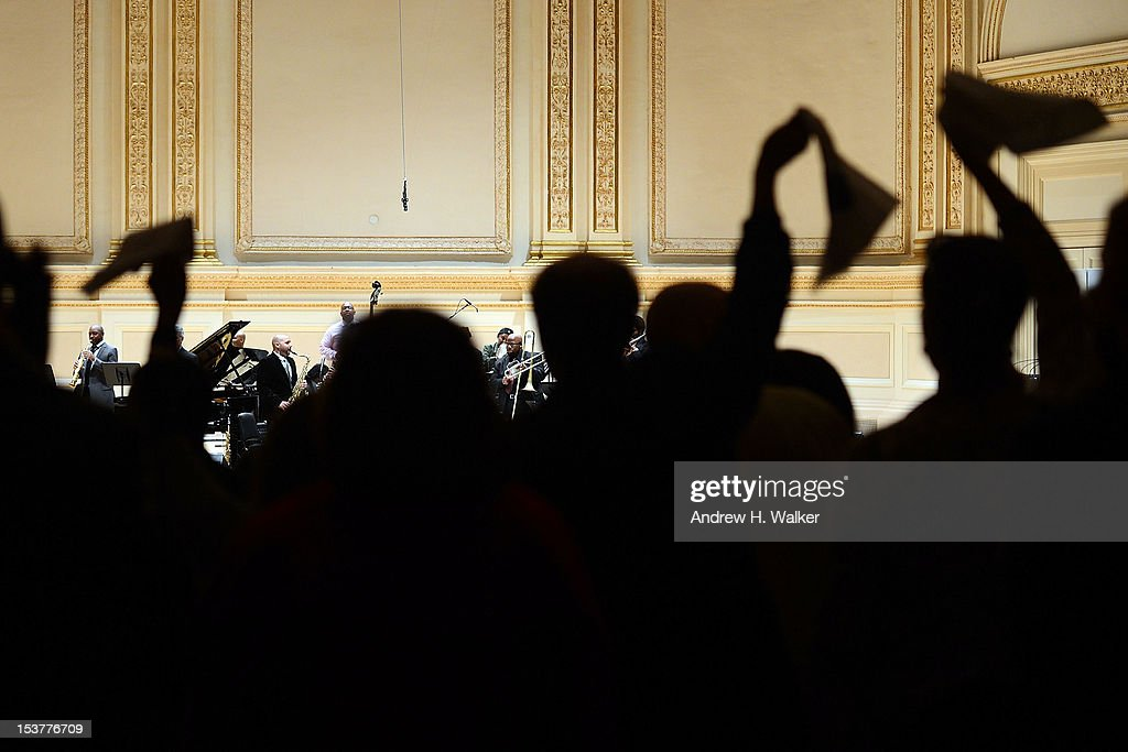 The audience cheers for The New Orleans Jazz Orchestra perform at Carnegie Hall on October 8, 2012 in New York, New York.