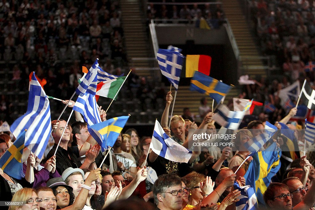 The audience cheers prior to the start of the semi-finals of the Eurovision Song Contest in Telenor Arena in Baerum, Norway, on May 25, 2010. The 55th Eurovision Song Contest finale will take place on May 29 in the Telenor Arena in Oslo, after Norwegian Alexander Rydbak took the top prize in Moscow last year with his song 'Fairytale'. AFP PHOTO/NORWAY/Cornelius Poppe ==NORWAY