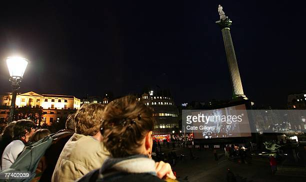 The audience in Trafalgar Square as pianist Neil Brand provides the accompaniment to archive films being shown on the big screen on October 18 in...