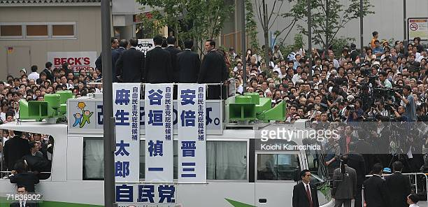 The audience listens to Japan's Liberal Democratic Party candidate Chief Cabinet Secretary Shinzo Abe during joint public speeches on the street in...