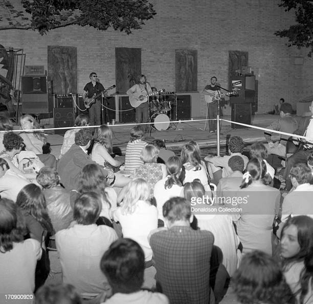 The audience looks on as soft rock band Orpheus performs in the sculpture garden of the Museum of Modern Art on August 1 1969 in New York City New...