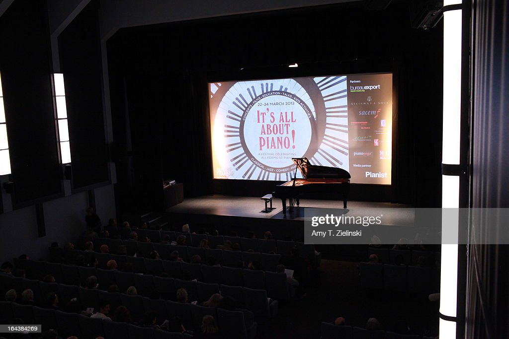 The audience takes their seats before pianist Imogen Cooper performs an all Schubert program at a Steinway grand piano on stage in Cine Lumiere during 'It's All About Piano!' festival inside the The Institut Francais on March 22, 2013 in London, England. The festival is a collaboration from French Music Office to celebrate the piano with recitals from classical to jazz, film screenings, children's activities, workshops and cinema screenings exploring the musical instrument.