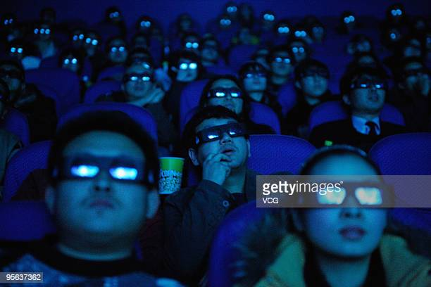 The Audience watch the 3D film 'Avatar' through 3D glasses at a cinema on January 7 2009 in Taiyuan Shanxi province of China