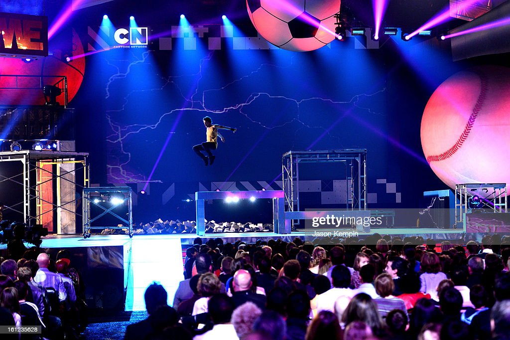 The audience watches a performer get airborne onstage at the Third Annual Hall of Game Awards hosted by Cartoon Network at Barker Hangar on February 9, 2013 in Santa Monica, California. 23270_003_JK_0429.JPG