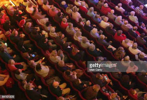 The audience watches as the production of the traditional pantomime Jack and the Beanstalk is shown on stage at the Theatre Royal Bath on December 20...