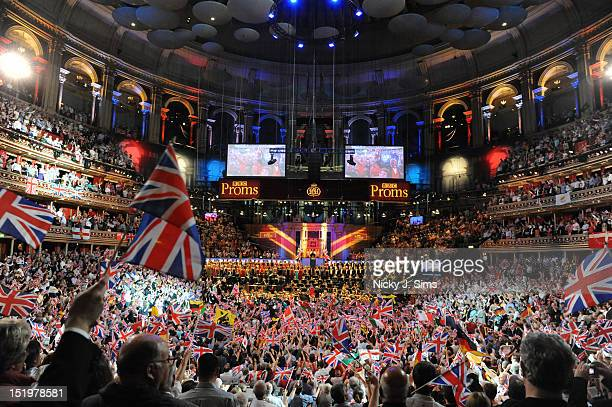 The audience wave flags and sing along as Jiri Belhlavek conducts the BBC Symphony Orchestra and the BBC Symphony Choir on stage during the climax of...