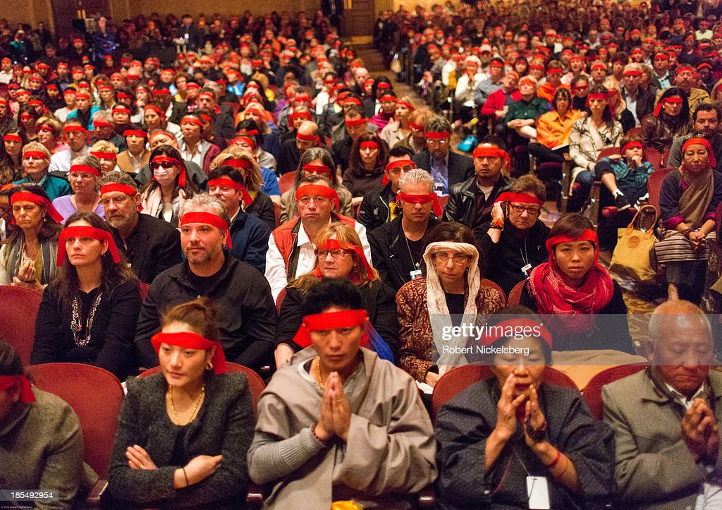 The audience wears a 'blindfold' during an initiation ceremony given by the Dalai Lama at the Beacon Theater October 20, 2013 in New York City. The Dalai Lama is in New York City for three days of his Buddhist teachings that run October 18-20. The teachings are supported by the Richard Gere Foundation.