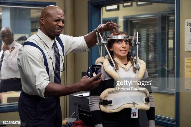 NINE 'The Audit' Episode 413 Pictured Terry Crews as Terry Jeffords Chelsea Peretti as Gina Linetti
