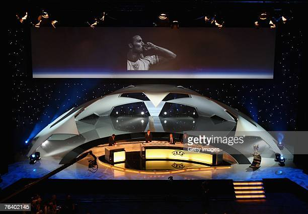 The auditorium stands for a moments silence in respect for Antonio Puerta the Sevilla player who died during the UEFA Champions League Draw at the...