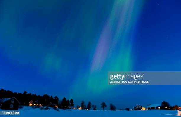 The Aurora Borealis bright up the sky at twilight on March 17 2013 between the towns of Are and Ostersund Sweden AFP PHOTO/JONATHAN NACKSTRAND / AFP...