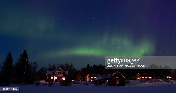 The Aurora Borealis bright up the sky at twilight on March 17 2013 between the towns of Are and Ostersund Sweden AFP PHOTO/JONATHAN NACKSTRAND
