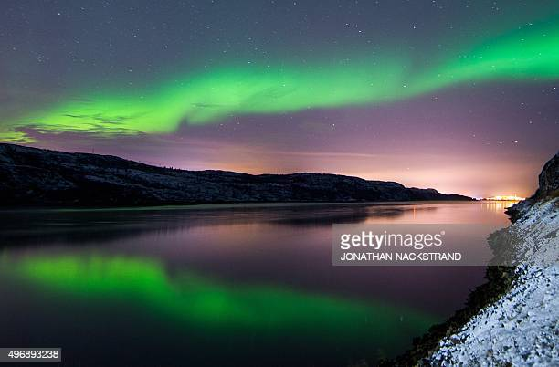 The Aurora Borealis or Northern Lights illuminate the night sky on November 12 2015 near the town of Kirkenes in northern Norway AFP PHOTO / JONATHAN...