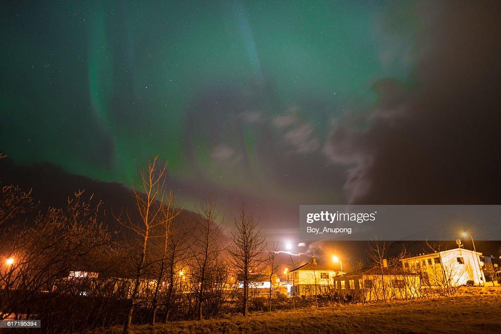 The Aurora Borealis over the Stodvarfjordur town in East Iceland. : Stock Photo