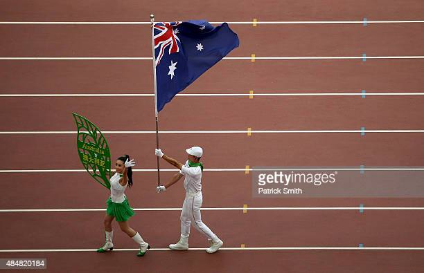 The Australia flag bearer parades during the Opening Ceremony for the 15th IAAF World Athletics Championships Beijing 2015 at Beijing National...