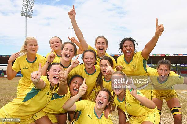 The Australia girls rugby sevens team celebrate after defeating Canada in the girls rugby sevens final at the Apia Park Sports Complex on day five of...