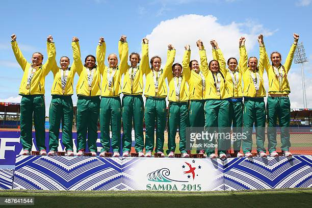 The Australia girls rugby sevens team pose with their gold medals after defeating Canada in the girl rugby sevens final at the Apia Park Sports...
