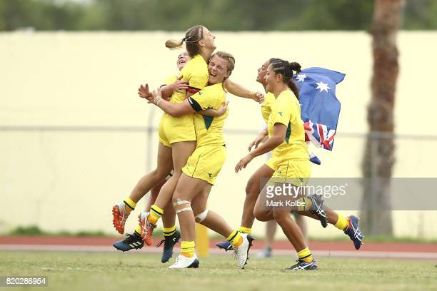 The Australia girls team celebrate victory in the Girl's Rugby 7's Gold medal Final on day 4 of the 2017 Youth Commonwealth Games at QE Sports Centre...