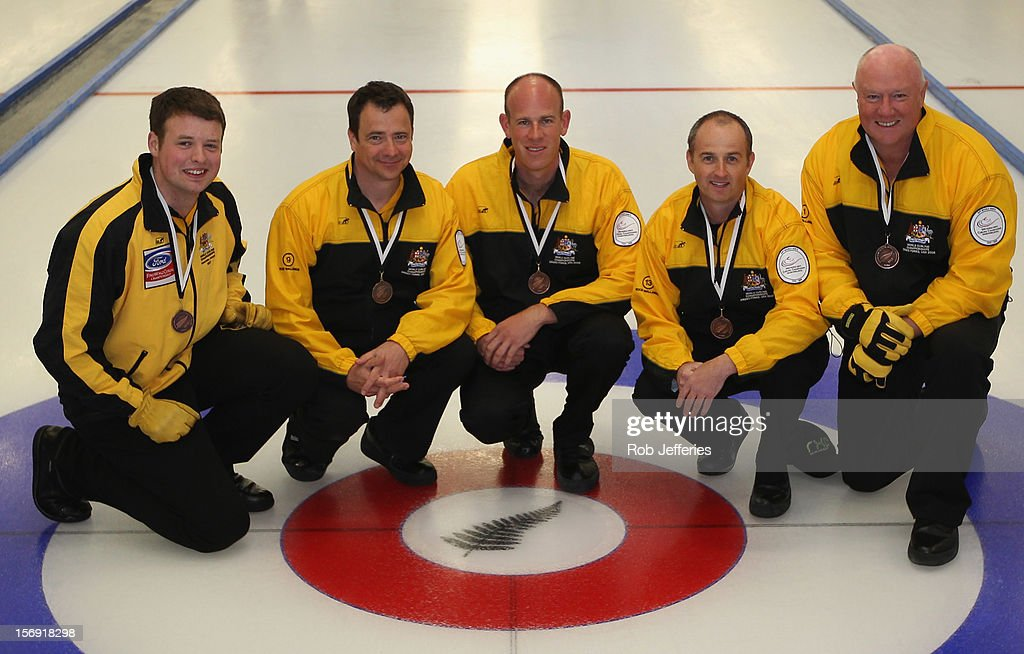 The Australia men's team of Hugh Millikin, Ian Palangio, Sean Hall, Stephen Jones and <a gi-track='captionPersonalityLinkClicked' href=/galleries/search?phrase=Angus+Young&family=editorial&specificpeople=789698 ng-click='$event.stopPropagation()'>Angus Young</a> pose for a photo during the Pacific Asia 2012 Curling Championship at the Naseby Indoor Curling Arena on November 25, 2012 in Naseby, New Zealand.