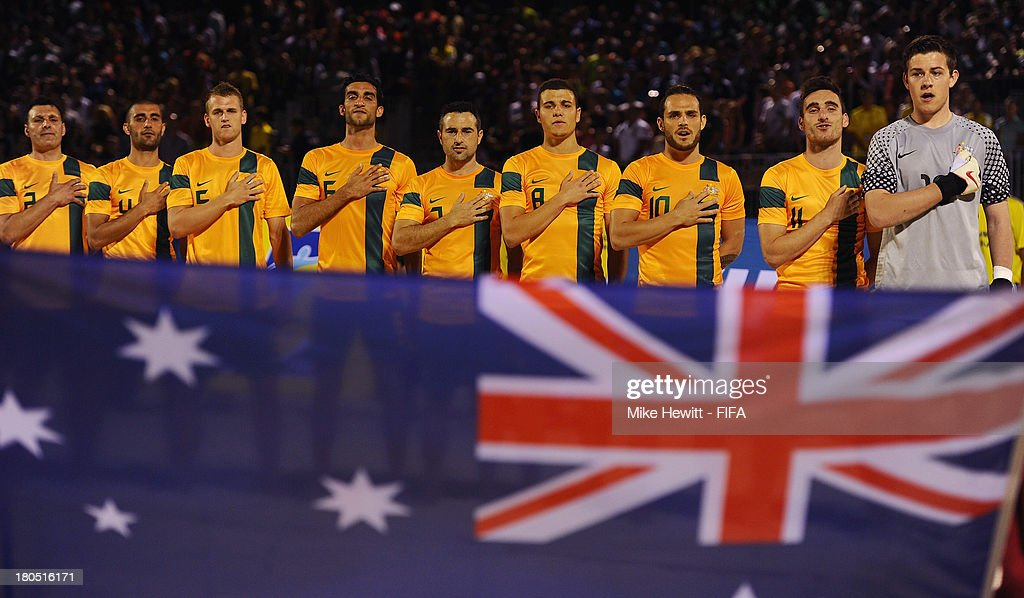 The Australia players sing their national anthem ahead of a friendly match between Tahiti and Australia after the Welcome Ceremony for the FIFA Beach Soccer World Cup Tahiti 2013 at the Tahua To'ata Stadium on September 13, 2013 in Papeete, French Polynesia.