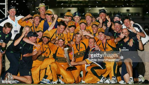 The Australia team and coaching staff celebrate after winning the World Cup Final against Sri Lanka by 53 runs at the Kensington Oval Bridgetown...