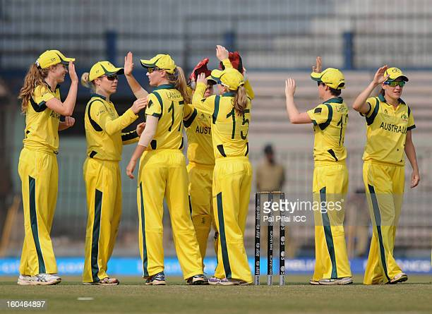 The Australia team celebrate after winning the second match of ICC Womens World Cup between Australia and Pakistan played at the Barabati stadium on...