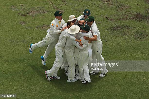 The Australia team celebrate the wicket of Ben Stokes of England during day five of the Third Ashes Test Match between Australia and England at WACA...