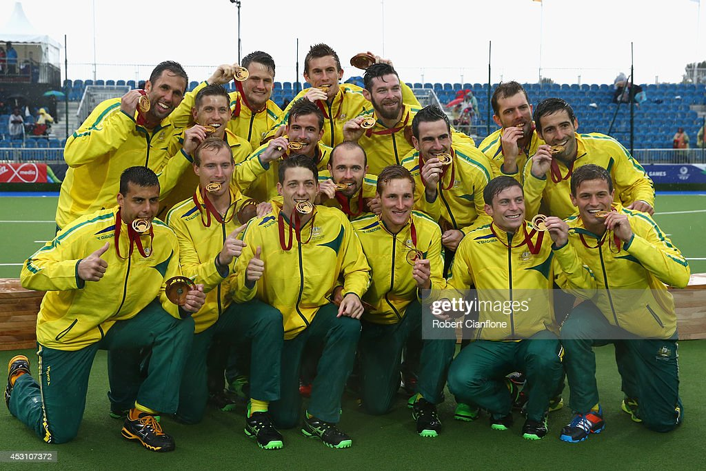The Australia team celebrate with their Gold Medals after winning the Men's Gold Medal Match Final between India and Australia at Glasgow National Hockey Centre during day eleven of the Glasgow 2014 Commonwealth Games on August 3, 2014 in Glasgow, United Kingdom.