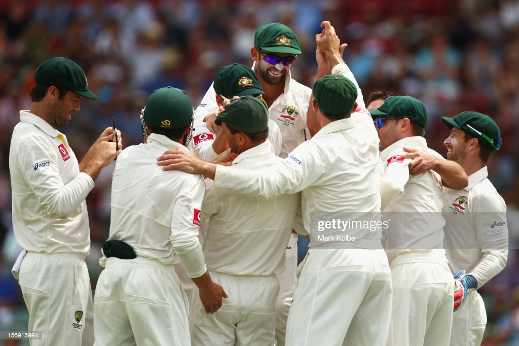 The Australia team congratulate Ben Hilfenhaus of Australia as celebrates taking the wicket of Graeme Smith of South Africa during day four of the Second Test Match between Australia and South Africa at Adelaide Oval on November 25, 2012 in Adelaide, Australia.