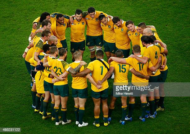 The Australia team huddle after their victory during the 2015 Rugby World Cup Quarter Final match between Australia and Scotland at Twickenham...