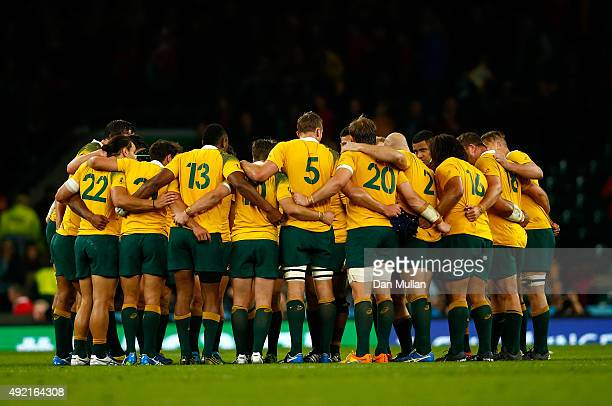 The Australia team huddle as they celebrate victory after the 2015 Rugby World Cup Pool A match between Australia and Wales at Twickenham Stadium on...