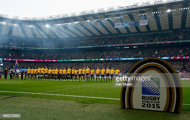The Australia team line up for the national anthem during the 2015 Rugby World Cup Quarter Final match between Australia and Scotland at Twickenham...