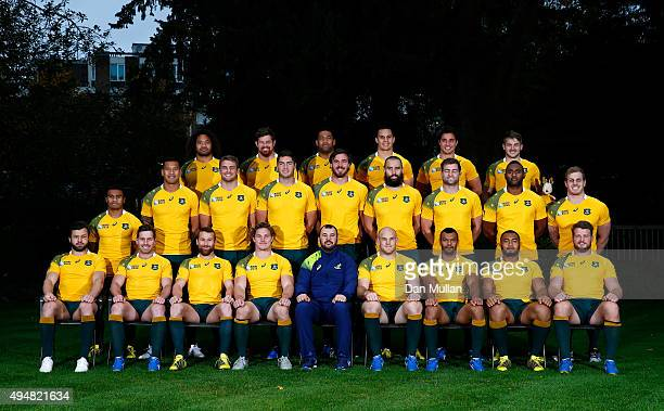 The Australia team named for the 2015 Rugby World Cup Final against New Zealand pose for a photo with Michael Cheika Head Coach of Australia during...