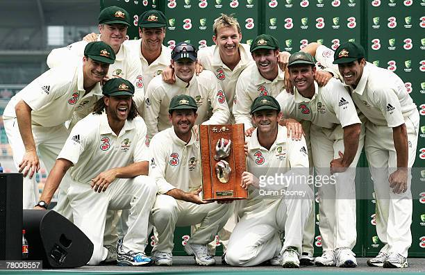 The Australia team pose with the Muralitharan Warne Trophy after winning the match and the series during day five of the Second test match between...