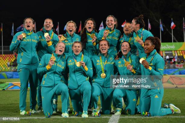 The Australia team pose with their gold medals following victory during the Women's Rugby Sevens Gold Medal match between Australia and New Zealand...