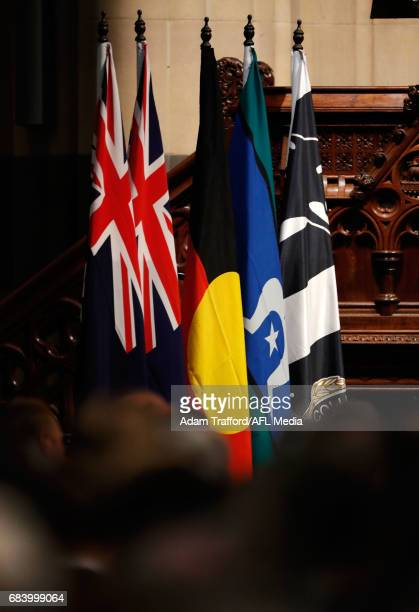 The Australian Aboriginal Torres Strait Islander and Collingwood magpies flags are seen during the former Collingwood legend Lou Richards state...