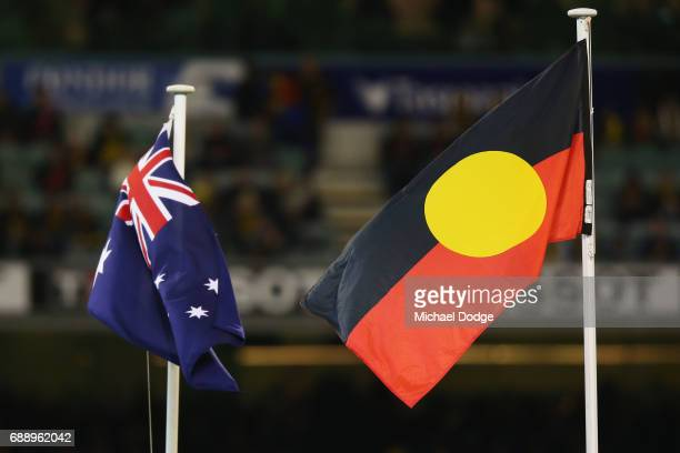 The Australian and Indigenous flags stand togther during the round 10 AFL match between the Richmond Tigers and the Essendon Bombers at Melbourne...