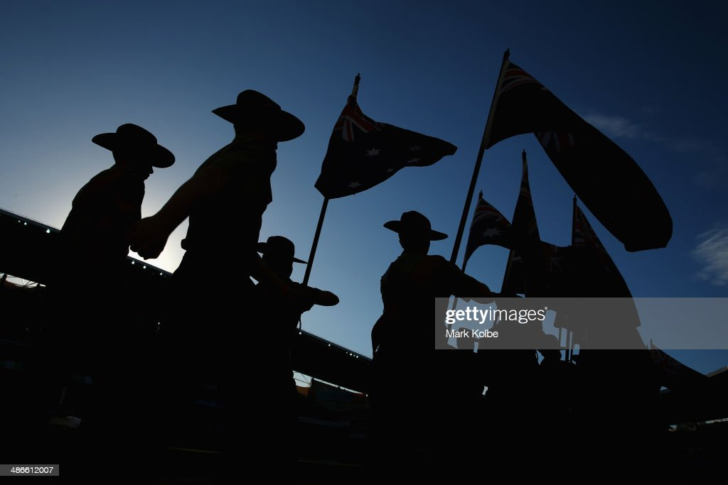 The Australian Army Cadet Unit carry the Australian and New Zealand flags during the pre-match ceremony ahead of the ANZAC Cup round 8 NRL match between the St George Illawarra Dragons and the Sydney Roosters at Allianz Stadium on April 25, 2014 in Sydney, Australia.