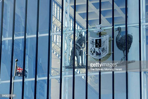 The Australian coat of arms with the Australian flag reflected in the window at the High Court in Canberra on 4 May 2006 during the challenge to the...