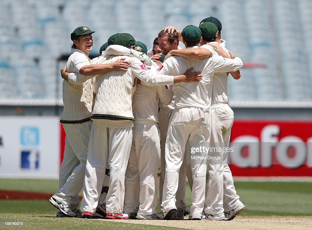 The Australian cricket team celebrate the last wicket to win the match during day three of the Second Test match between Australia and Sri Lanka at Melbourne Cricket Ground on December 28, 2012 in Melbourne, Australia.