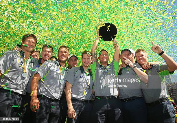 The Australian cricket team pose with the trophy during celebrations after winning the 2015 ICC Cricket World Cup Final at Federation Square on March...